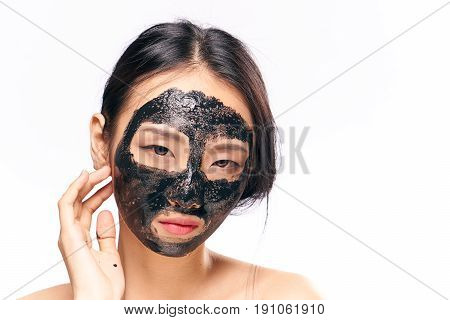 Facial, woman in cosmetic mask on isolated background.