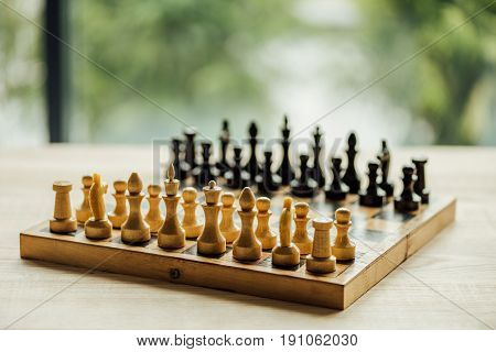Old Chess Board Set For A New Game On The Table. Selective Focus On White Chess Figures