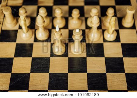 High Angle View Of Part Of A Chess Board With Chess King And Queen Staying In Front Of White Chess P