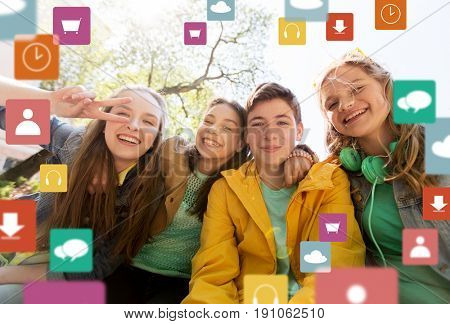 friendship, technology and people concept - happy teenage friends or high school students having fun and making faces with menu icon
