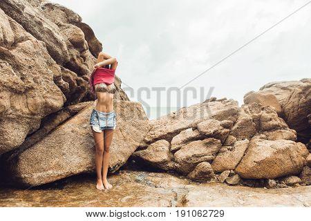 Sexy Girl Undress On Rock Beach.
