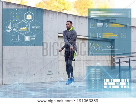 fitness, sport and people concept - man skipping with jump rope outdoors