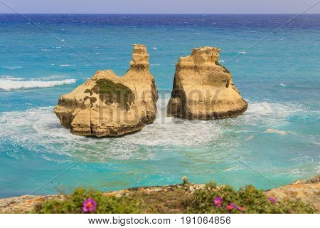 The most beautiful coast of Apulia: Torre Dell'Orso Bay, ITALY (Lecce).Typical seascape of Salento: view of the two stacks called The Two Sisters (or Due Sorelle).