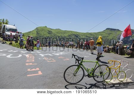 Pas de Peyrol France - July 62016: Spectators and fans waiting for the cyclists on the road to Pas de Pyerol (Puy Mary) in Cantalin the Central Massif during the stage 5 of Tour de France on July 6 2016.