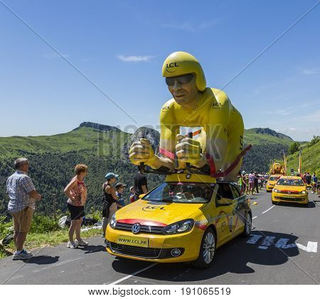 Pas de Peyrol France - July 62016: The specific LCL yellow mascot during the passing of the Publicity Caravan on the road to Pas de Pyerol (Puy Mary) in Cantalin the Central Massif during the stage 5 of Tour de France on July 6 2016.