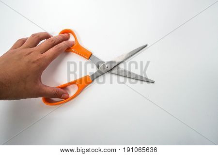 isolated close up women hold scissors for cutting with left hand