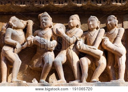 Sculptures of musicians on the external walls at Hindu temple in Khajuraho, India. Most Khajuraho temples were built between 950 and 1050 by the Chandela dynasty.