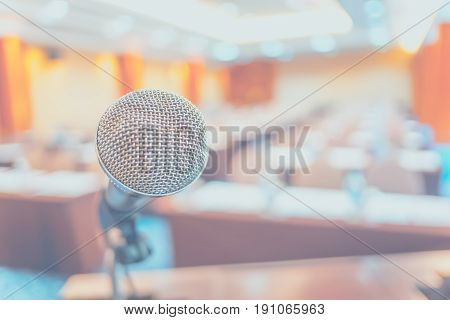 Blur Background,close Up Microphone At Podium At Seminar Event Room With Bokeh Light ,business Conce