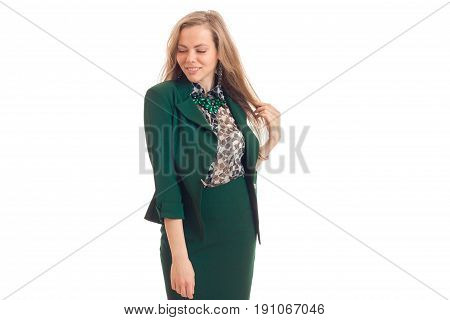 Cutie young blonde business woman in green uniform smiling with closed eyes isolated on white background