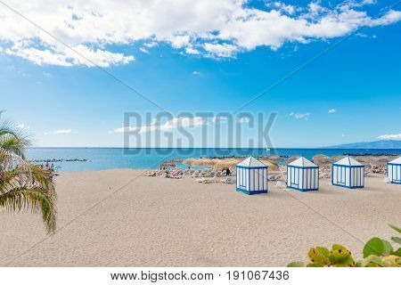 Playa El Duque beach with tropical palm trees in Costa Adeje. Tenerife Canary Islands Spain