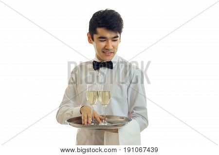 young brunette man waiter with champagne on tray smiling isolated on white background