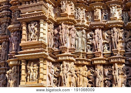 Bas-relief at famous ancient temple in Khajuraho, India. Most Khajuraho temples were built between 950 and 1050 by the Chandela dynasty.