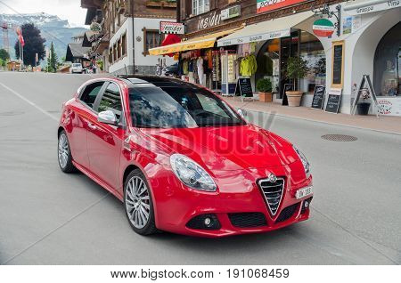 Alfa Romeo Car On Grindelwald Street. Switzerland