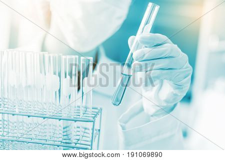 Scientist Hand Holding Laboratory Test Tube, Science Laboratory Research And Development Concept