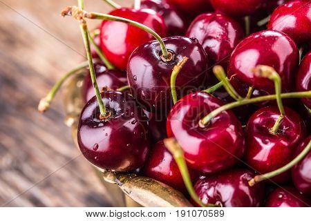 Cherries. Fresh sweet cherries. Delicious cherries on old oak table.