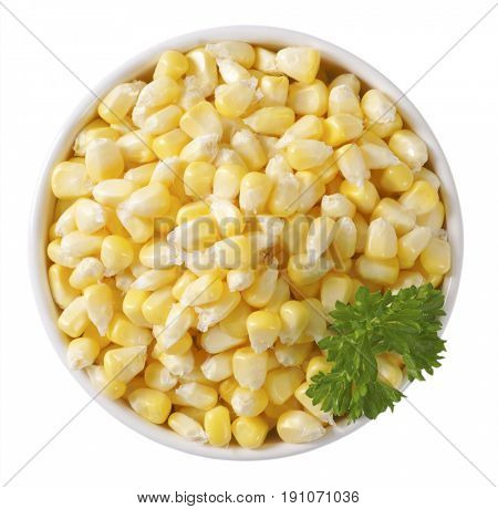 bowl of sweet corn kernels on off-white background with shadows