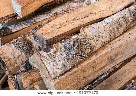 A pile of wood for burning stove in sauna.