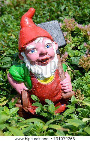 Engelberg, Switzerland - 12 August 2015: Garden gnome in a garden of a house at Engelberg on the Swiss alps