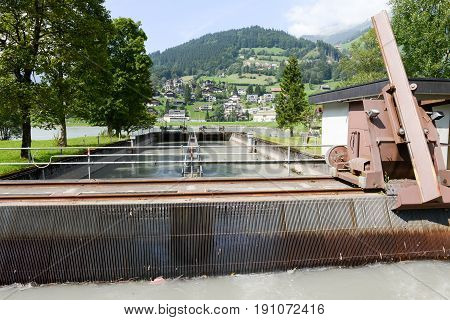 Barrage of water at power plant turbines for producing electricity of Engelberg on the Swiss alps