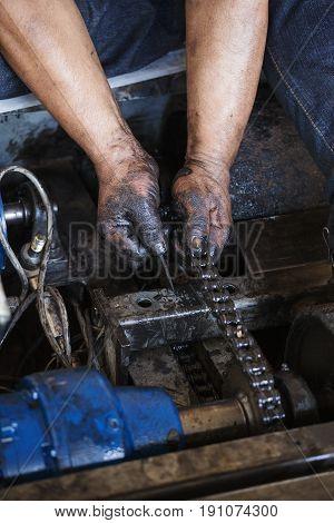 Hand During Maintenance Work Of Chain
