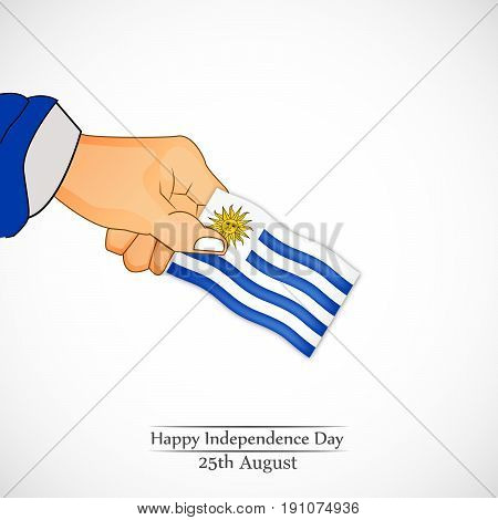 illustration of hand holding Uruguay flag with Happy Independence day 25th August text