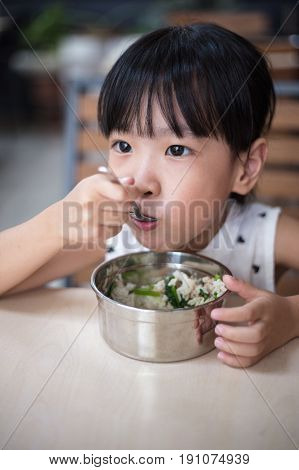 Asian Chinese Little Girl Eating Steamed Minced Pork And Rice