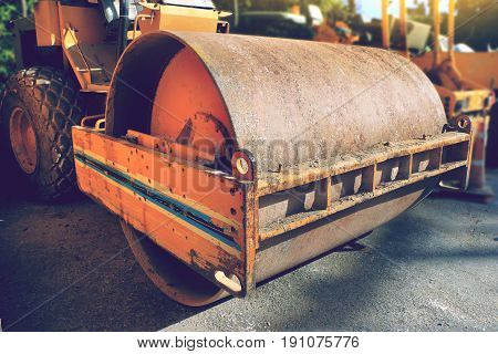 road roller compactor parked at road construction site