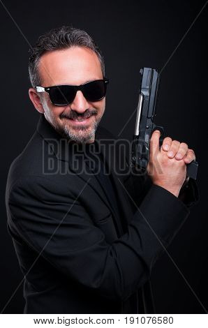 Handsome Killer Holding Up His Gun