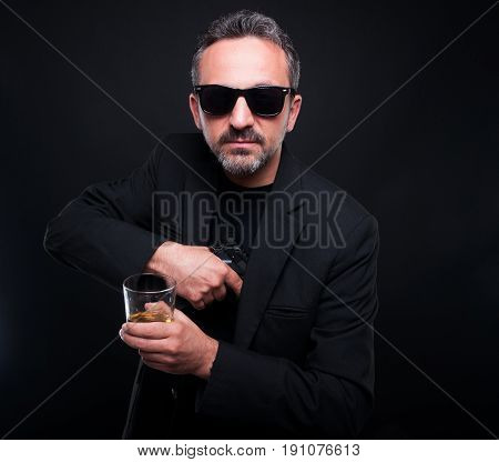Male Gangster Removing His Gun