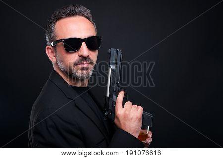 Mafia Member Holding A Gun Or Pistol