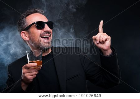 Cheerful Rich Male With A Glass Of Whiskey