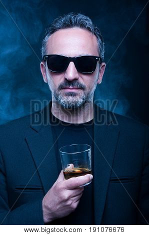 Portrait Of Classy Man Drinking Expensive Whiskey