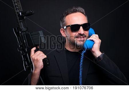 Gun Man Dealer Talking On Phone