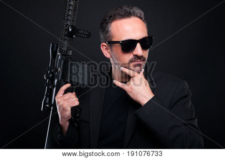 Pensive Gangster With Dangerous Rifle