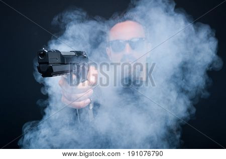 Mafia Boss Holding Pistol Thru Smoke