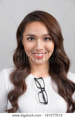Close Up Portrait Of Smiling Confident Businesswoman Looking Straight, Isolated On Grey Background.