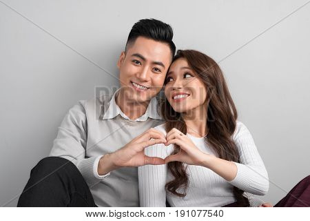 Young Asian Couple Make Heart Symbol From Their Hands