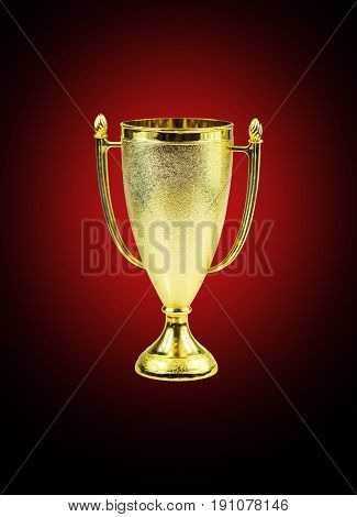 Golden trophy cup isolated on a red- black background