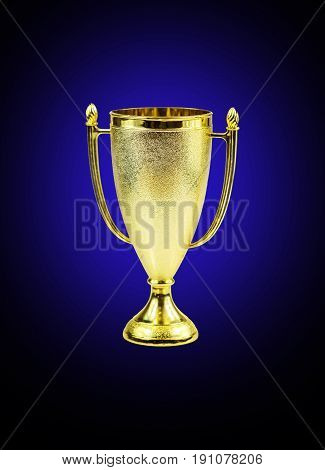 Golden trophy cup isolated on a blue- black background