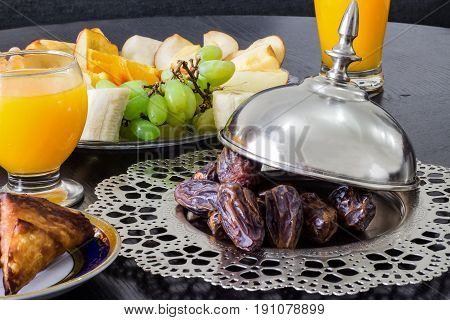 Dried Date Medjool Palm Fruits, Fresh Orange Juice, Samosa Snack And Fruit Background Concept Iftar