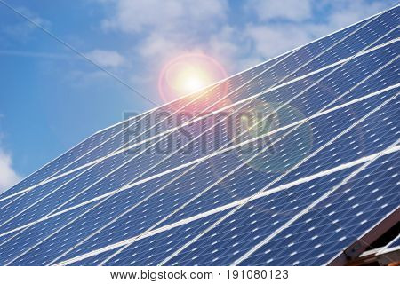 Solar panel with reflection of sun in summer