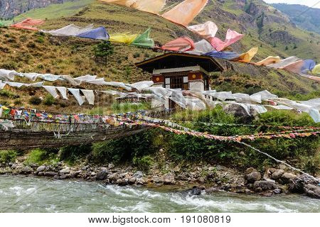 Prayer Flags On The Iron Bridge Of Tamchog Lhakhang Monastery, Paro River, Bhutan