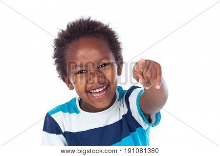 Cute kid pointing with his finger isolated on white background