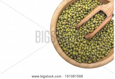 Mung bean and olive wood scoop isolated on white background. Top view