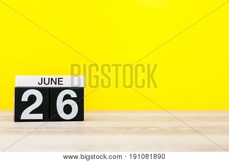June 26th. Day 26 of month, calendar on yellow background. Summer day. Empty space for text. International Day against drug abuse and illicit trafficking.