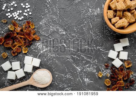 lumps of sugar with bowls sweet set on dark kitchen table background top view mockup