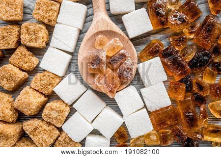 sugar in lumps for sweet food cooking on kitchen gray table background top view pattern