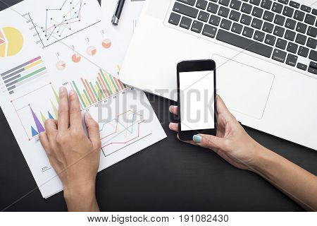 business accountant with document graph financial and smart phone on office table. concept planning budget and audit.
