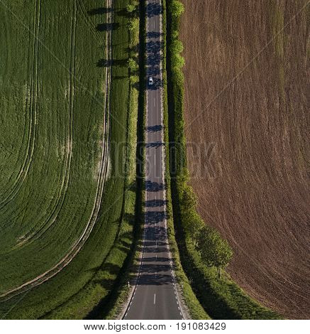 Abstract, surreal landscape, bend perspective road through the field with copy space