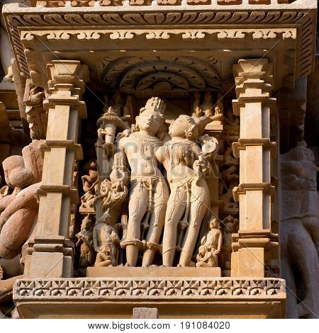 Mahadev Shiva and Parvati - ancient bas-relief at famous erotic temple in Khajuraho, India. Most Khajuraho temples were built between 950 and 1050 by the Chandela dynasty.